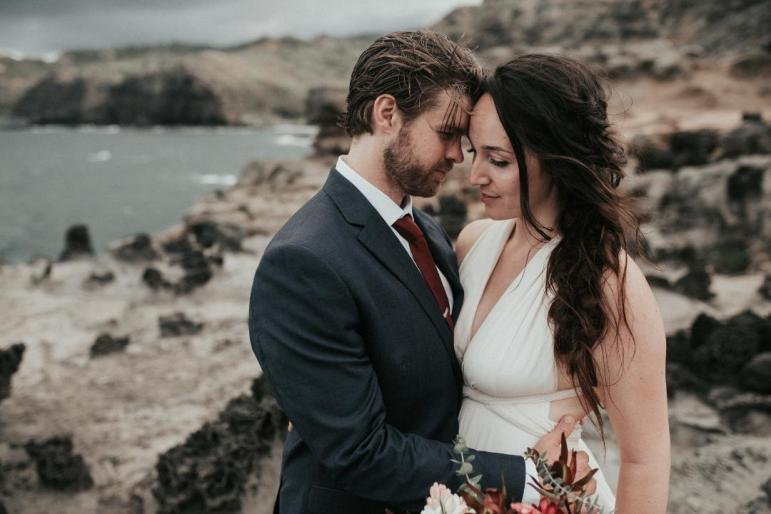 This one was super special! They came all the way from Oregon to elope here. And she was set for bride and groom photos at the Nakalele Point ( Blow Hole). We hiked down. They had their hiking shoes on and wearing the wedding attire. It was super adventurous and we made amazing photographs.